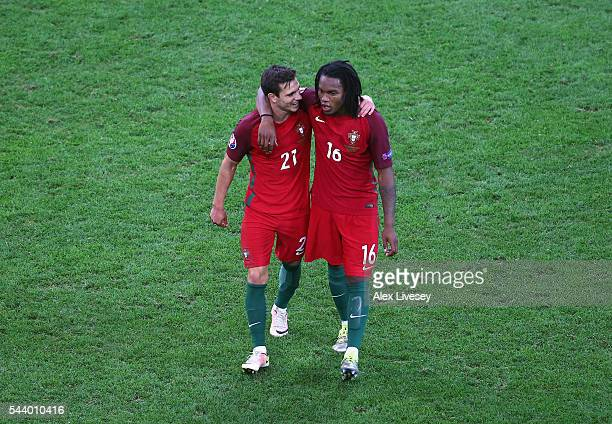 Cedric Soares and Renato Sanches of Portugal celebrate their team's win after the UEFA EURO 2016 quarter final match between Poland and Portugal at...