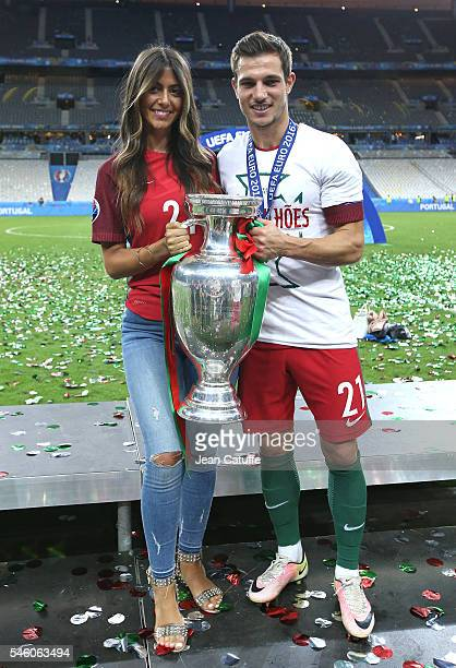 Cedric Soares of Portugal poses with the trophy following the UEFA Euro 2016 final match between Portugal and France at Stade de France on July 10...