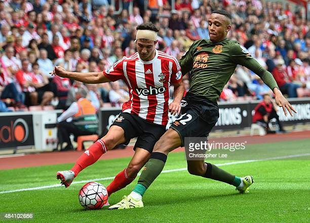 Cedric Soares of Southampton and Brendan Galloway of Everton compete for the ball during the Barclays Premier League match between Southampton and...