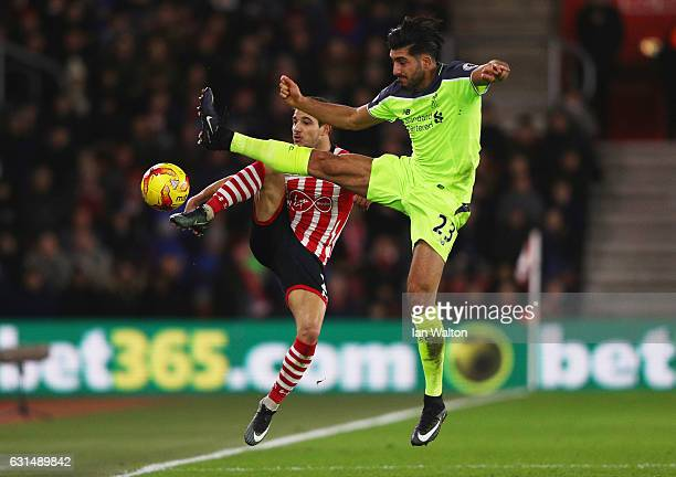 Cedric Soares of Southampton and Emre Can of Liverpool battle for the ball during the EFL Cup semifinal first leg match between Southampton and...