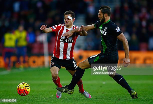 Cedric Soares of Southampton and Erik Pieters of Stoke City compete for the ball during the Barclays Premier League match between Southampton and...