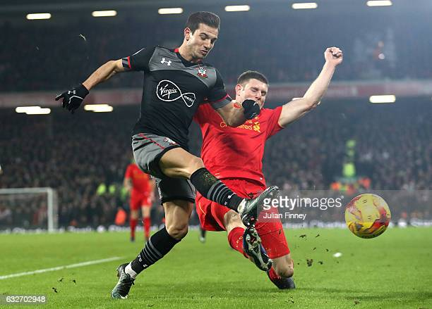 Cedric Soares of Southampton and James Milner of Liverpool clash during the EFL Cup SemiFinal Second Leg match between Liverpool and Southampton at...