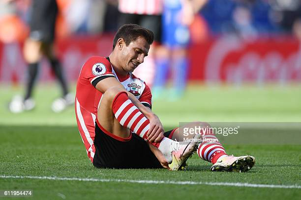 Cedric Soares of Southampton holds his ankle during the Premier League match between Leicester City and Southampton at The King Power Stadium on...