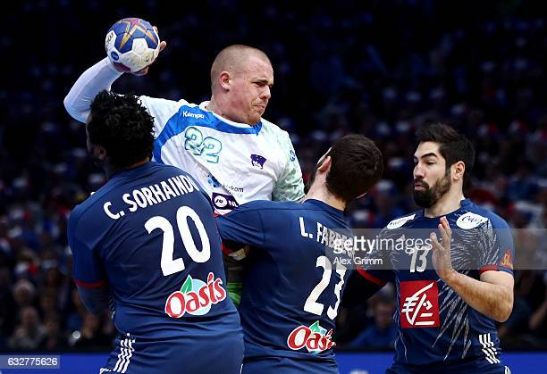 Cedric Sorhaindo Ludovic Fabregas and Nikola Karabatic of France challenges Matej Gaber of Slovenia during the 25th IHF Men's World Championship 2017...