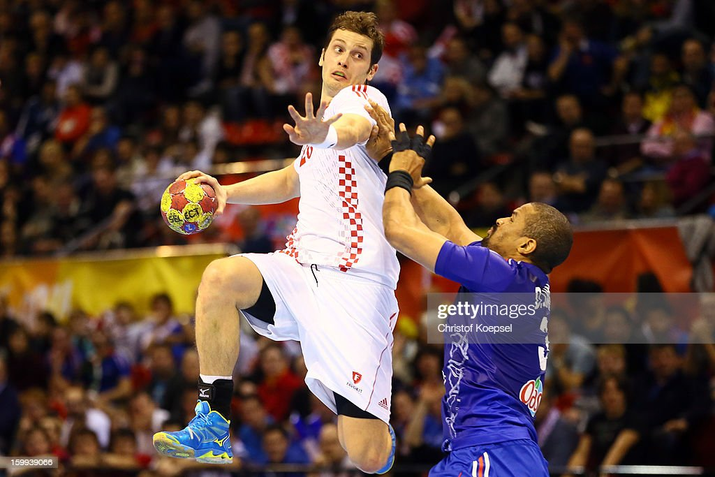 Cedric Sorhaindo of France (R) defends against Domagoj Duvnjak of Croatia (L) during the quarterfinal match between France and Croatia at Pabellon Principe Felipe Arena on January 23, 2013 in Barcelona, Spain.