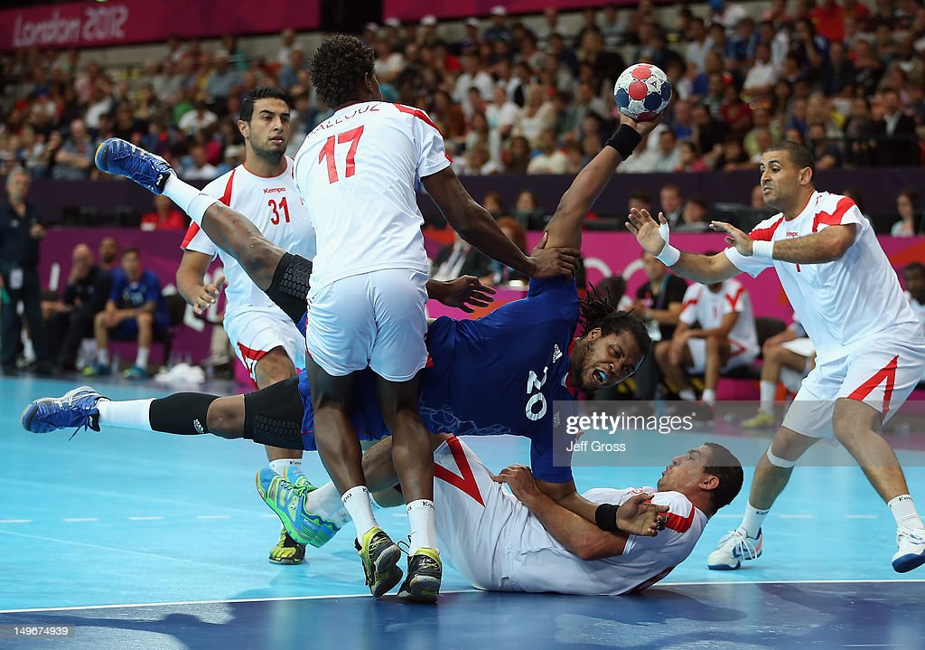 <a gi-track='captionPersonalityLinkClicked' href=/galleries/search?phrase=Cedric+Sorhaindo&family=editorial&specificpeople=564416 ng-click='$event.stopPropagation()'>Cedric Sorhaindo</a> #20 of France is fouled by <a gi-track='captionPersonalityLinkClicked' href=/galleries/search?phrase=Issam+Tej&family=editorial&specificpeople=2085539 ng-click='$event.stopPropagation()'>Issam Tej</a> (second from right) #6 of Tunisia in the Men's Preliminaries Group A match between France and Tunisia on Day 6 of the London 2012 Olympic Games at The Copper Box on August 2, 2012 in London, England.