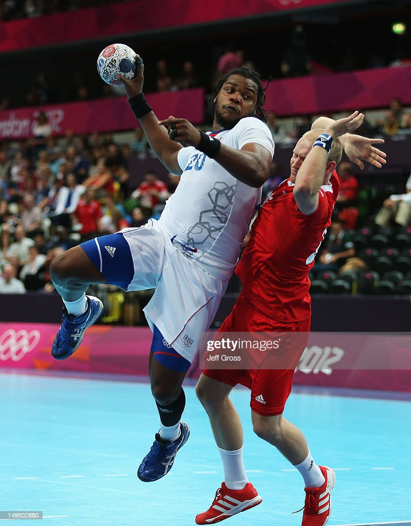 <a gi-track='captionPersonalityLinkClicked' href=/galleries/search?phrase=Cedric+Sorhaindo&family=editorial&specificpeople=564416 ng-click='$event.stopPropagation()'>Cedric Sorhaindo</a> of France jumps to shoot during the Men's Handball preliminaries group A match between France and Great Britain on Day 2 of the London 2012 Olympic Games at the Copper Box on July 29, 2012 in London, England.