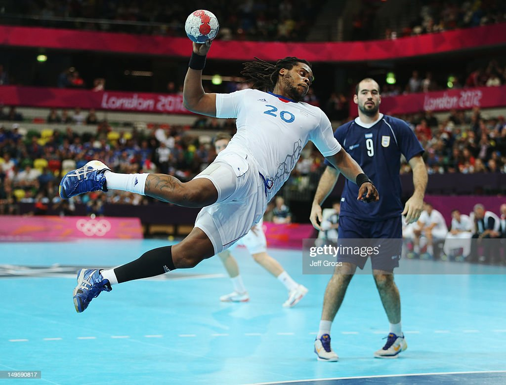 <a gi-track='captionPersonalityLinkClicked' href=/galleries/search?phrase=Cedric+Sorhaindo&family=editorial&specificpeople=564416 ng-click='$event.stopPropagation()'>Cedric Sorhaindo</a> of France shoots for goal during the Men's Handball Preliminary match between Argentina and France on Day 4 of the London 2012 Olympic Games at The Copper Box on July 31, 2012 in London, England.