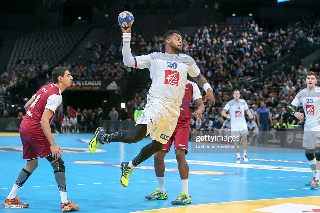 <a gi-track='captionPersonalityLinkClicked' href=/galleries/search?phrase=Cedric+Sorhaindo&family=editorial&specificpeople=564416 ng-click='$event.stopPropagation()'>Cedric Sorhaindo</a> #20 of France shoots the ball against Abdulrazzaq Ahmad Murad #11 of Qatar during the Golden League game between France and Qatar at Accord Hotels Arena on January 9, 2016 in Paris, France.