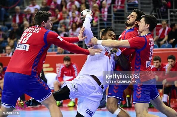 TOPSHOT Cedric Sorhaindo of France vies with Mijajlo Marsenic Nemanja Zelenovi and Ilija Abutovic of Serbia during the Men's 2016 EHF European...