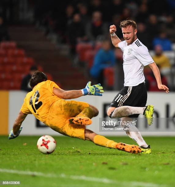 Cedric Teuchert of Germany scores 60 against goalkeeper Mustafa Ozhitay of Azerbaijan during the UEFA Under21 Euro 2019 Qualifier match between U21...