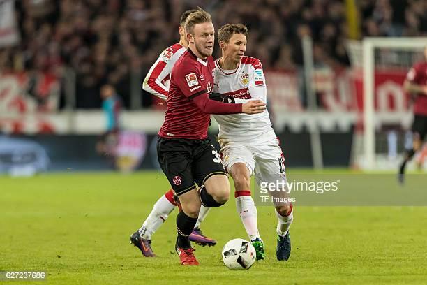 Cedric Teuchert of Nuernberg and Florian Klein of Stuttgart battle for the ball during the second Bundesliga match between VfB Stuttgart and 1 FC...