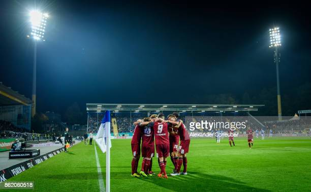 Cedric Teuchert of Nuernberg celebrates the third goal for his team with his teammates during the Second Bundesliga match between SV Darmstadt 98 and...