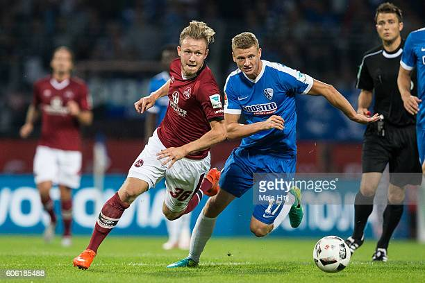 Cedric Teuchert of Nuernberg is challenged by Pawel Dawidowicz of Bochum during the Second Bundesliga match between VfL Bochum 1848 and 1 FC...