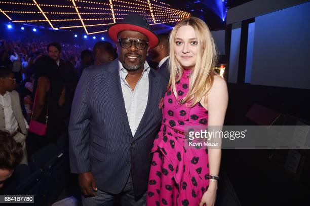 Cedric the Entertainer and Dakota Fanning attend the Turner Upfront 2017 show at The Theater at Madison Square Garden on May 17 2017 in New York City...