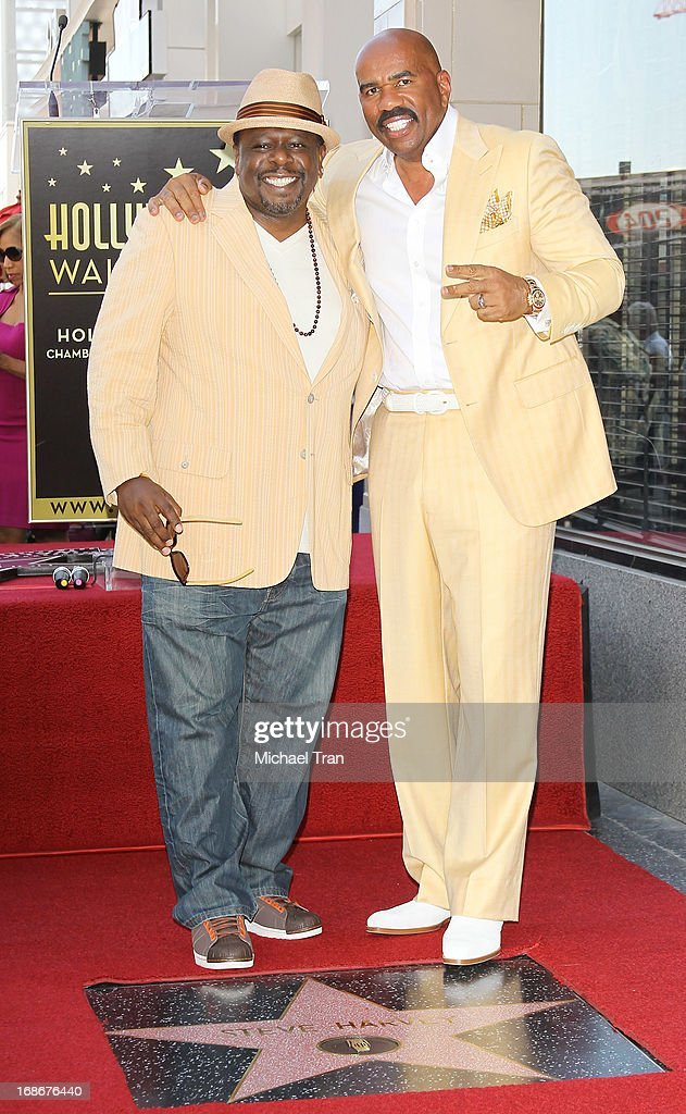 <a gi-track='captionPersonalityLinkClicked' href=/galleries/search?phrase=Cedric+the+Entertainer&family=editorial&specificpeople=210583 ng-click='$event.stopPropagation()'>Cedric the Entertainer</a> (L) and <a gi-track='captionPersonalityLinkClicked' href=/galleries/search?phrase=Steve+Harvey&family=editorial&specificpeople=210865 ng-click='$event.stopPropagation()'>Steve Harvey</a> attend the ceremony honoring <a gi-track='captionPersonalityLinkClicked' href=/galleries/search?phrase=Steve+Harvey&family=editorial&specificpeople=210865 ng-click='$event.stopPropagation()'>Steve Harvey</a> with a Star on The Hollywood Walk of Fame held on May 13, 2013 in Hollywood, California.