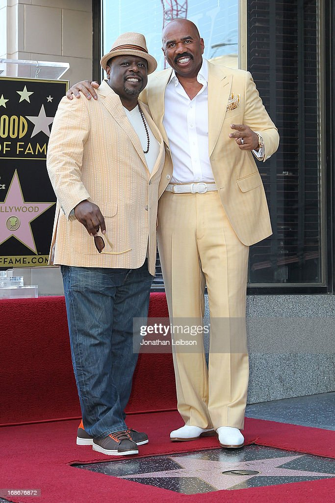 <a gi-track='captionPersonalityLinkClicked' href=/galleries/search?phrase=Cedric+the+Entertainer&family=editorial&specificpeople=210583 ng-click='$event.stopPropagation()'>Cedric the Entertainer</a> and <a gi-track='captionPersonalityLinkClicked' href=/galleries/search?phrase=Steve+Harvey&family=editorial&specificpeople=210865 ng-click='$event.stopPropagation()'>Steve Harvey</a> attend the ceremony honoring <a gi-track='captionPersonalityLinkClicked' href=/galleries/search?phrase=Steve+Harvey&family=editorial&specificpeople=210865 ng-click='$event.stopPropagation()'>Steve Harvey</a> with a Star on The Hollywood Walk of Fame held on May 13, 2013 in Hollywood, California.