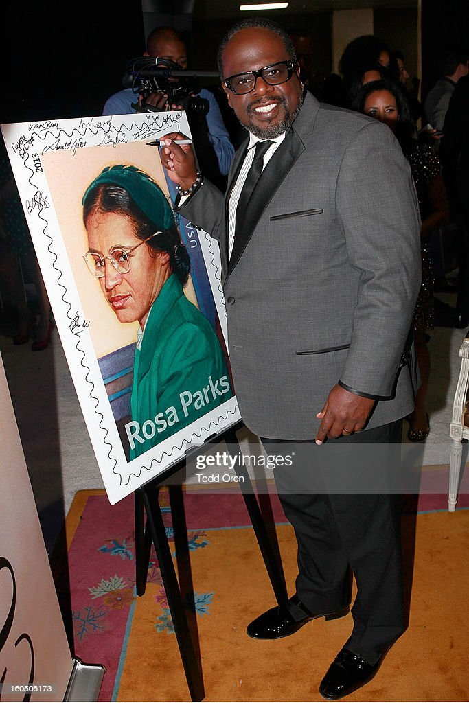 Cedric the Entertainer previews the Rosa Parks Forever Stamp in the U.S. Postal Service Civil Rights Stamp Gallery backstage at the NAACP Image Awards on February 1, 2013 at The Shrine Auditorium.