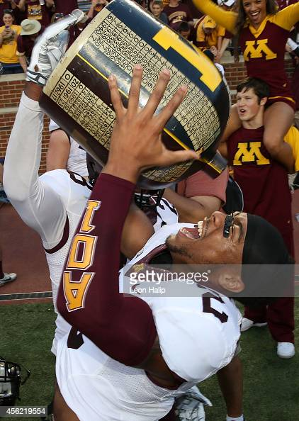 Cedric Thompson of the Minnesota Golden Gophers celebrates a win over the Michigan Wolverines with the Little Brown Jug at Michigan Stadium on...