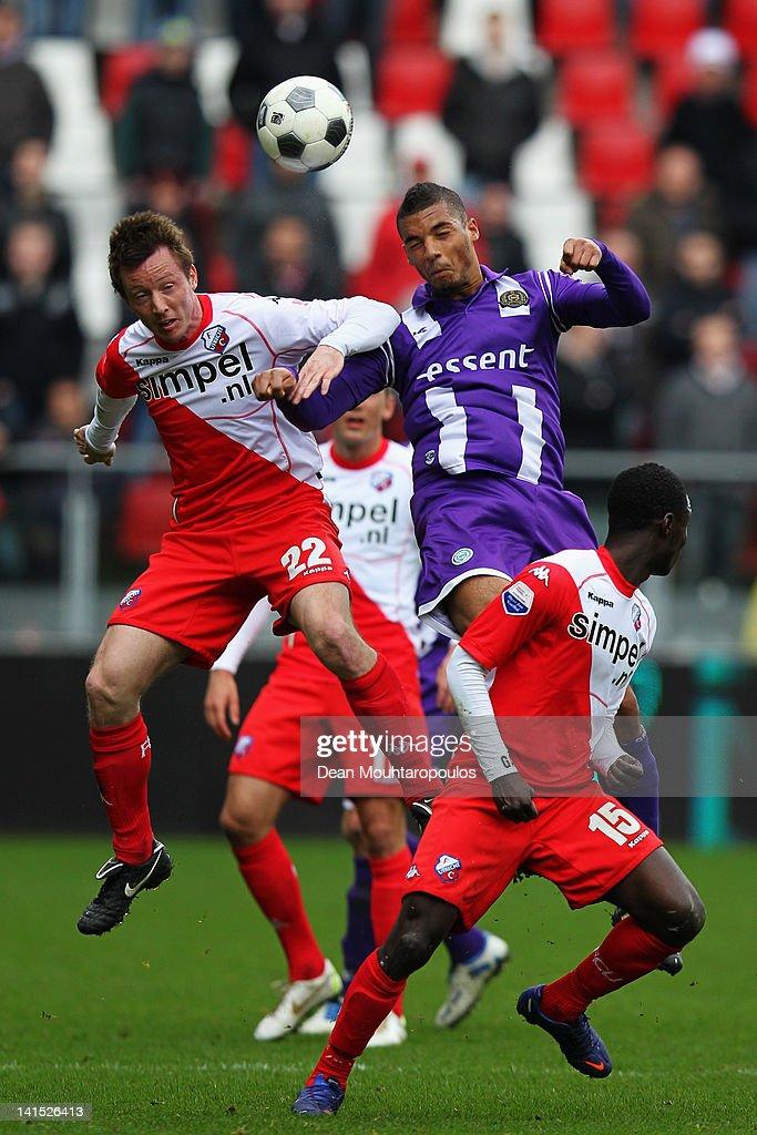 Cedric van der Gun of Utrecht and Johan Kappelhof of Groningen battle for the ball during the Eredivisie match between FC Utrecht and FC Groningen on...