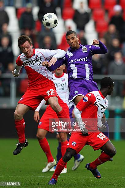 Cedric van der Gun of Utrecht and Johan Kappelhof of Groningen battle for the ball during the Eredivisie match between FC Utrecht and FC Groningen on...
