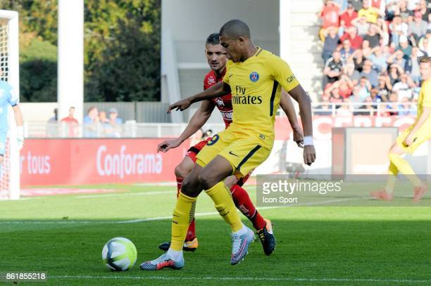 Cedric Varrault of Dijon and Kylian MBappe of PSG during the Ligue 1 match between Dijon FCO and Paris Saint Germain at Stade Gaston Gerard on...