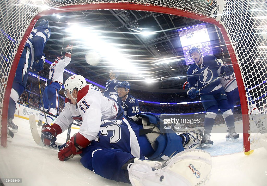 Cedrick Desjardins #30 of the Tampa Bay Lightning misses a goal scored by <a gi-track='captionPersonalityLinkClicked' href=/galleries/search?phrase=Brendan+Gallagher&family=editorial&specificpeople=3704208 ng-click='$event.stopPropagation()'>Brendan Gallagher</a> #11 of the Montreal Canadiens during the third period of the game at the Tampa Bay Times Forum on March 9, 2013 in Tampa, Florida.