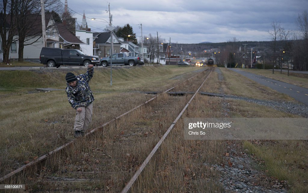 Cedrick Gregoire plays on the down hill sloping track where the runaway MMA train rolled towards town in LacMegantic Cedrick's father Sylvain...