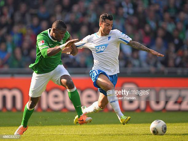 Cedrick Makiadi of Bremen is challenged by Jiloan Hamad of Hoffenheim during the Bundesliga match between Werder Bremen and 1899 Hoffenheim at...