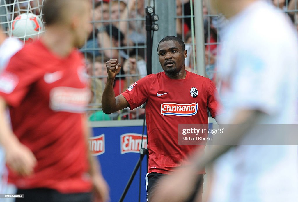 <a gi-track='captionPersonalityLinkClicked' href=/galleries/search?phrase=Cedrick+Makiadi&family=editorial&specificpeople=635003 ng-click='$event.stopPropagation()'>Cedrick Makiadi</a> of Freiburg celebrates after scoring the opening goal of the Bundesliga match between SC Freiburg and FC Augsburg at MAGE SOLAR Stadium on May 5, 2013 in Freiburg, Germany.