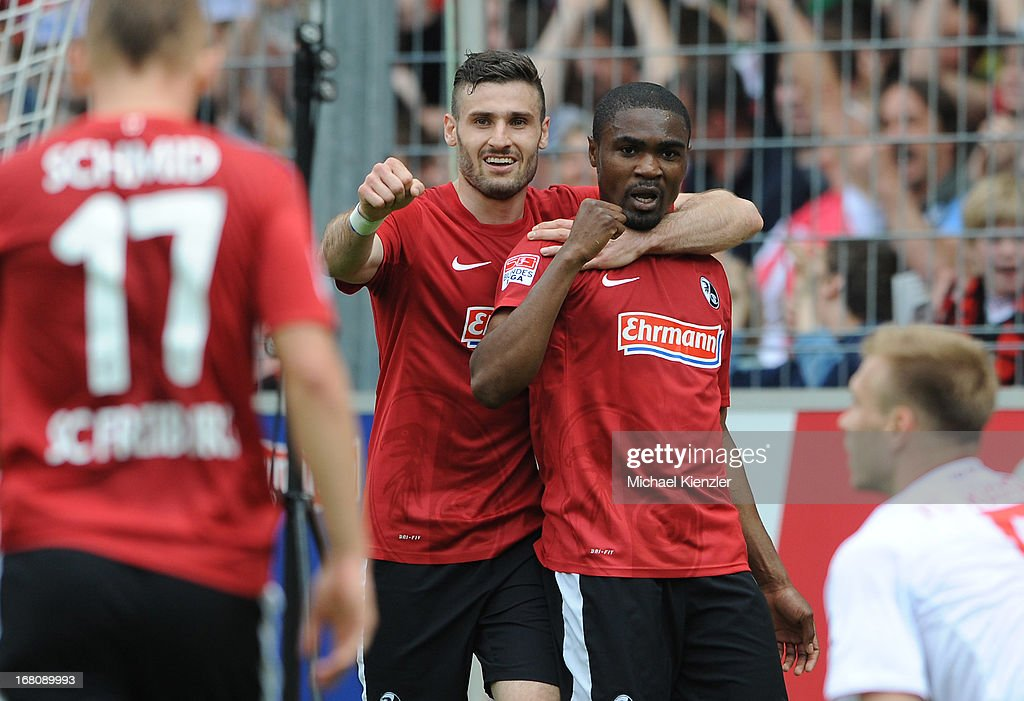 <a gi-track='captionPersonalityLinkClicked' href=/galleries/search?phrase=Cedrick+Makiadi&family=editorial&specificpeople=635003 ng-click='$event.stopPropagation()'>Cedrick Makiadi</a> of Freiburg (R) celebrates with team-mate Daniel Caligiuri after scorinig the opening goal of the Bundesliga match between SC Freiburg and FC Augsburg at MAGE SOLAR Stadium on May 5, 2013 in Freiburg, Germany.