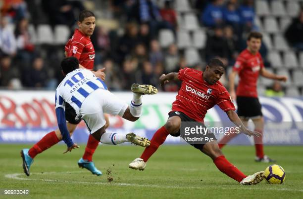 Cedrick Makiadi of Freiburg fouls Raffael of Berlin during the Bundesliga match between SC Freiburg and Hertha Berlin at Badenova Stadium on February...