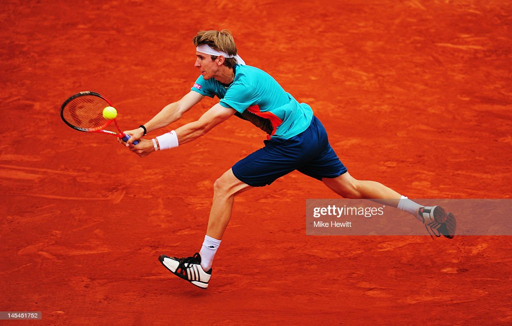 Cedrik- Marcel Stebe of Germany stretches to playa backhand during his men's singles second round match against Jo-Wilfried Tsonga of France during day four of the French Open at Roland Garros on May 30, 2012 in Paris, France.
