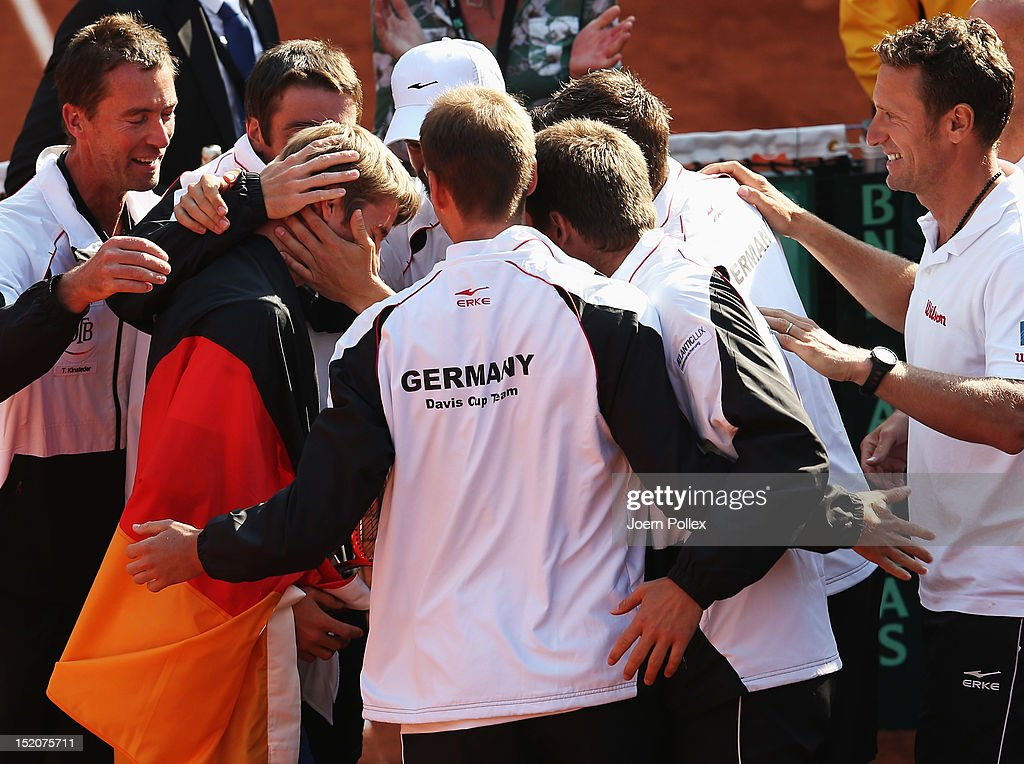 Cedrik-Marcel Stebe (2nd L) of Germany celebrates with his team after winning his match against Lleyton Hewitt of Australia during the Davis Cup World Group Play-Off match between Germany and Australia at Rothenbaum on September 16, 2012 in Hamburg, Germany.