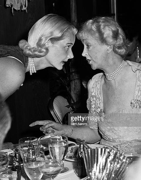 Cee Zee Guest and on the right Mme Louis Jacques Balsan talking at a party in Palm Beach circa 1955 Original publication A Wonderful Time Slim Aarons