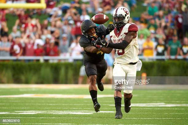 CeeDee Lamb of the Oklahoma Sooners makes a catch against Grayland Arnold of the Baylor Bears during the first half at McLane Stadium on September 23...
