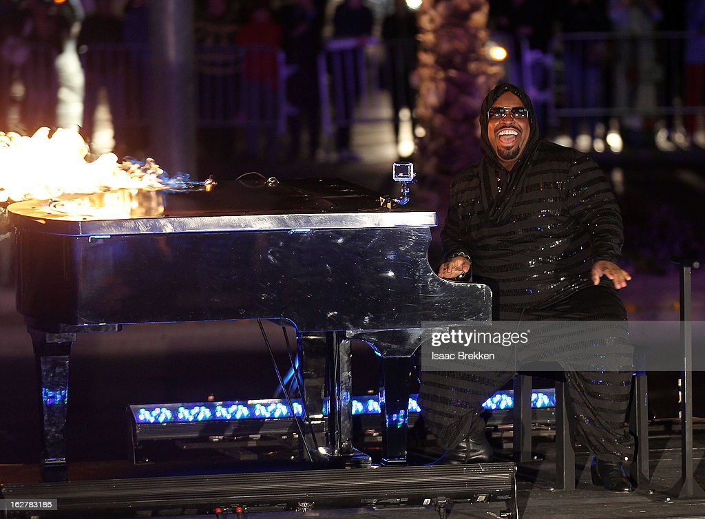 CeeLo Green plays a flaming piano down the Las Vegas Strip as he arrives at Planet Hollywood Resort & Casino on February 26, 2013 in Las Vegas, Nevada.