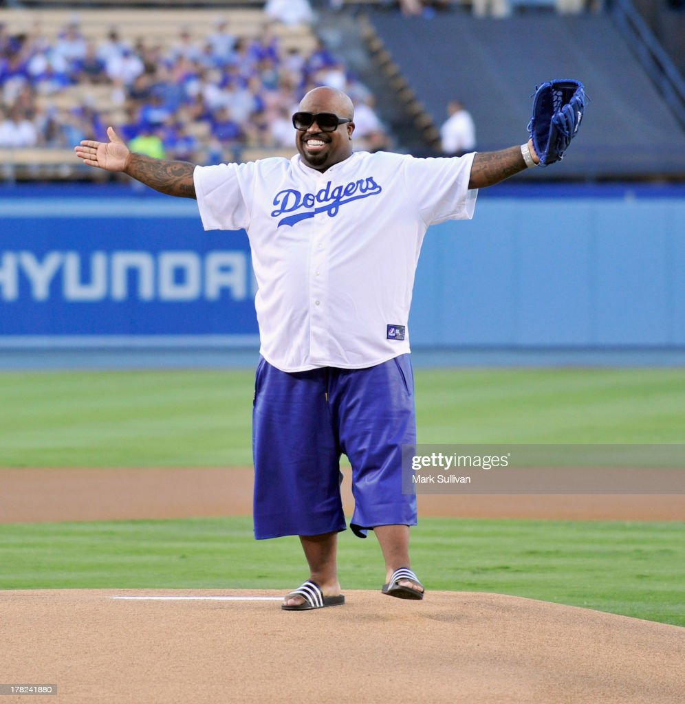 CeeLo Green throws out the ceremonial first pitch before the MLB game between the Chicago Cubs and Los Angeles Dodgers at Dodger Stadium on August 27, 2013 in Los Angeles, California.