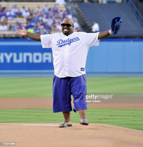 CeeLo Green throws out the ceremonial first pitch before the MLB game between the Chicago Cubs and Los Angeles Dodgers at Dodger Stadium on August 27...