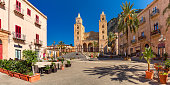 Panoramic vew of Cathedral-Basilica of Cefalu or Duomo di Cefalu and square Piazza del Duomo in the old town of coastal city Cefalu, Sicily, Italy