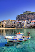 Boat moored in the port of Cefalu, Sicily