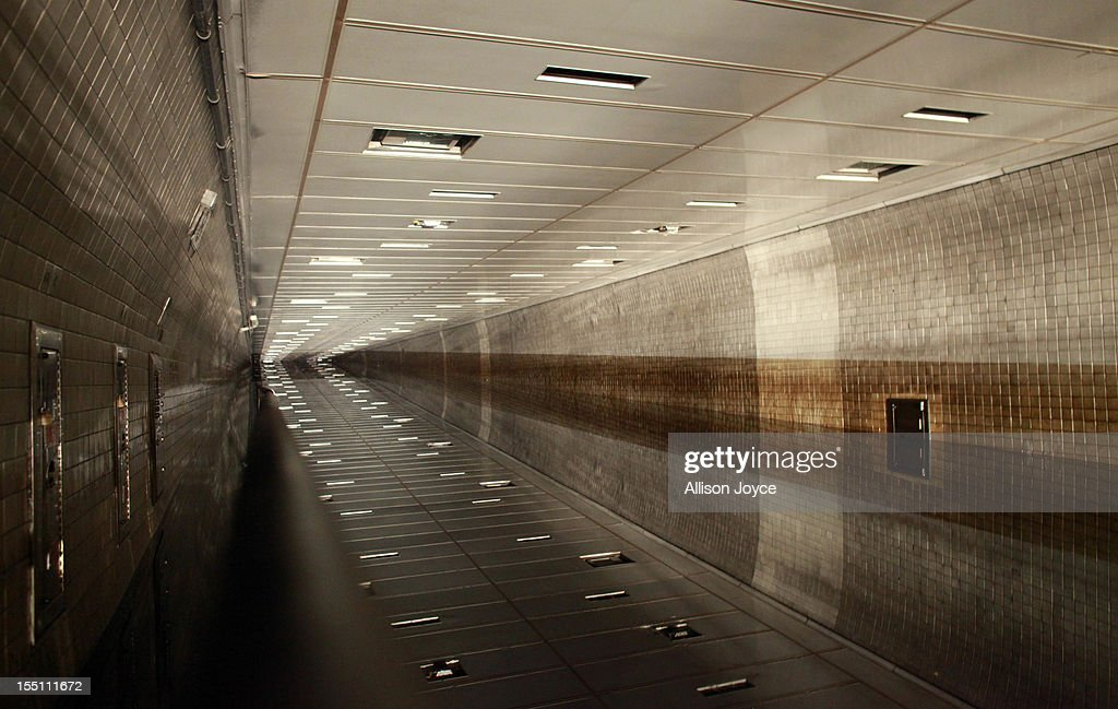 Ceiling tiles are reflected in flood water in the Hugh L. Carey Tunnel November 1, 2012 in New York City. Limited public transit has returned to New York. With the death toll continuing to rise and millions of homes and businesses without power, the U.S. east coast is attempting to recover from the effects of floods, fires and power outages brought on by Superstorm Sandy.