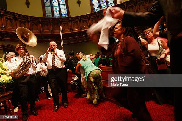 Celebrants dance during a church service honoring legendary Lindy Hop dancer Frankie Manning May 22 2009 in New York City Lindy Hop is an acrobatic...