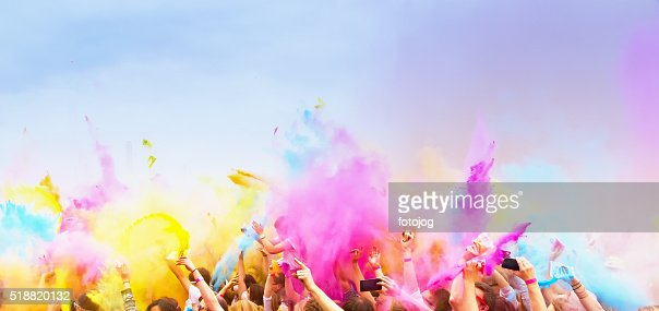 Celebrants dancing during the color Holi Festival : Stock Photo