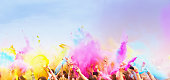 Happy , celebrants with smart phones dancing during the color Holi Festival