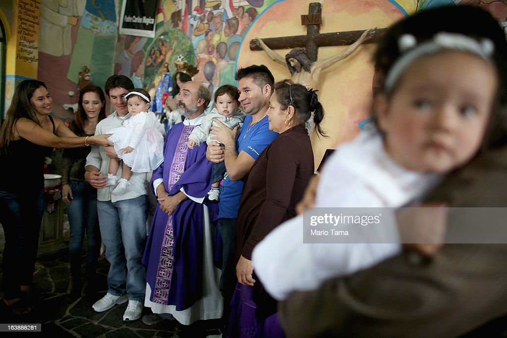 Celebrants gather for a photo in the Virgin of the Miracles of Caacupe church following Sunday Mass in the Villa 21-24 slum, where archbishop Jorge Mario Bergoglio, now Pope Francis, used to perform charity work, on March 17, 2013 in Buenos Aires, Argentina. Francis was the archbishop of Buenos Aires and is the first Pope to hail from South America. Some locals are now affectionately calling Francis, known for his charity work in the slums, the 'slum pope.'