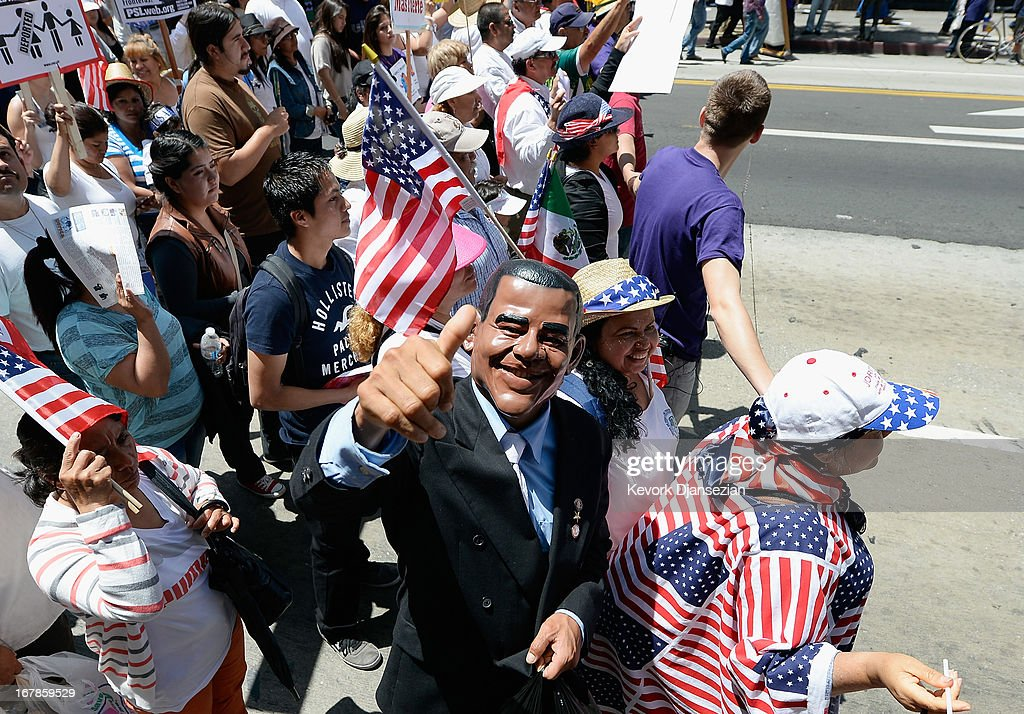 Celebrants participate in the May Day march and rally on May 1, 2013 in Los Angeles, California. Labor organizations and immigration groups used the annual celebration to push for an immigration system overhaul.