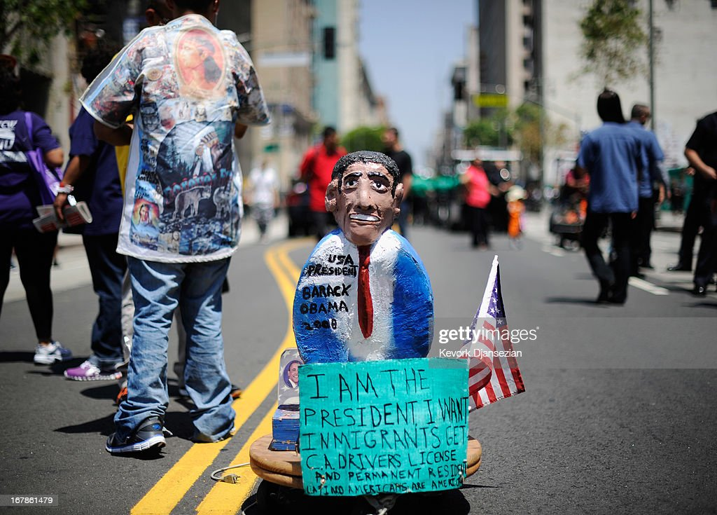 Celebrants participate in the May Day march and rally on May 1, 2013 in Los Angeles, United States. Labor organizations and immigration groups used the annual celebration to push for an immigration system overhaul.