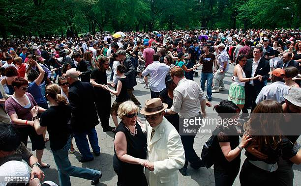 Celebrants swing dance in Central Park to honor legendary Lindy Hop dancer Frankie Manning May 22 2009 in New York City Lindy Hop is an acrobatic...