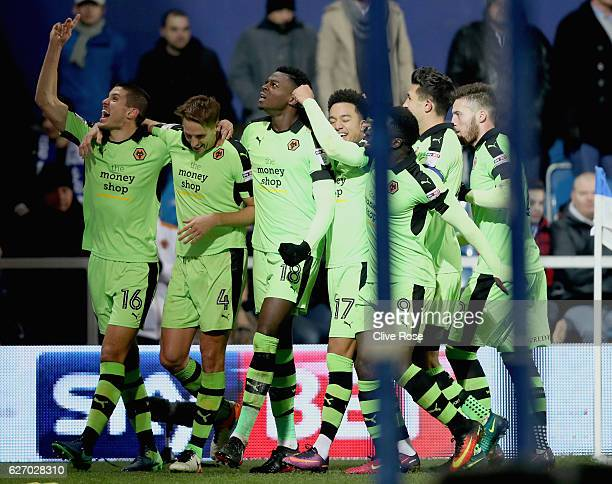 celebrates scoring his sides first goal with his Wolves team mates during the Sky Bet Championship match between Queens Park Rangers and...